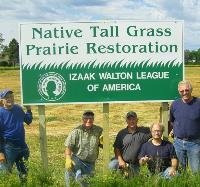 Members of the Kampeska Chapter in South Dakota with a sign marking their prairie restoration project