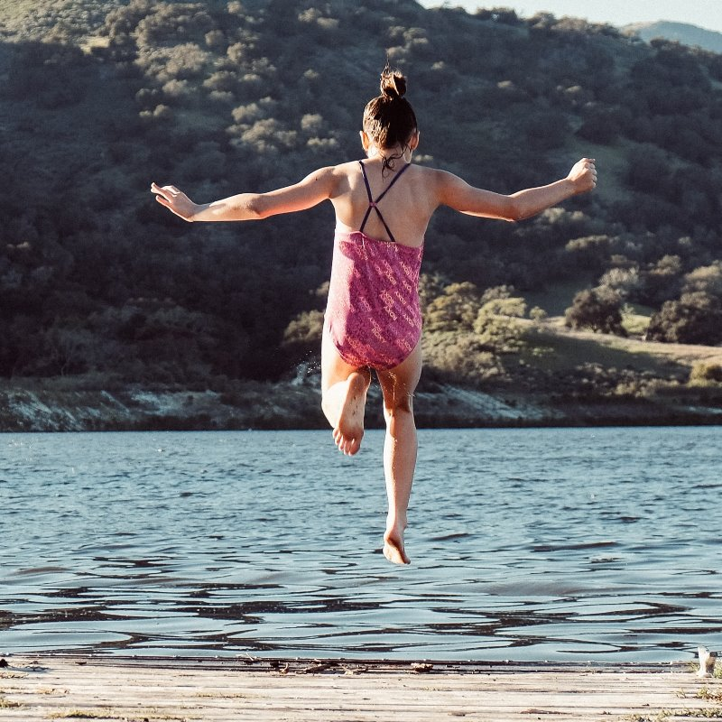 jumping into a lake_credit erik dungan_unsplash