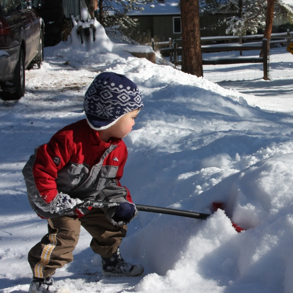 Boy shoveling snow. Credit David Gutierrez.