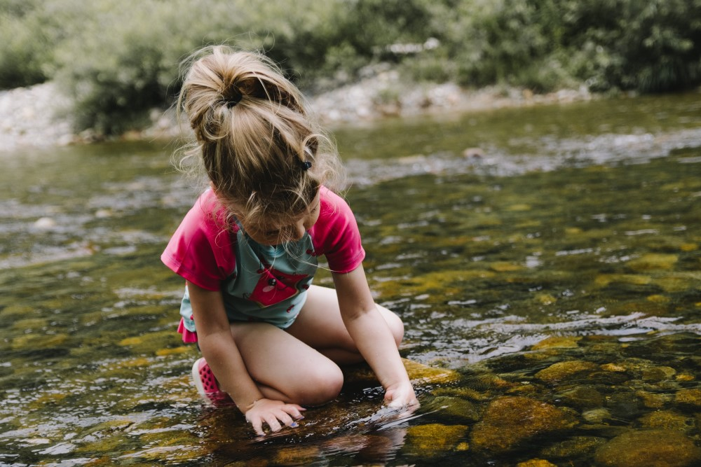 Young girl looking at water