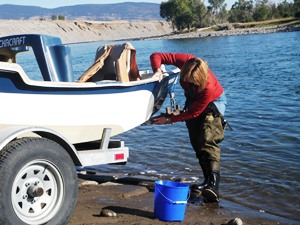 Cleaning Boat_credit Invasive Species Action Network