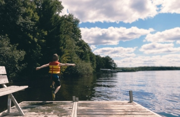 boy jumping off dock_pexels
