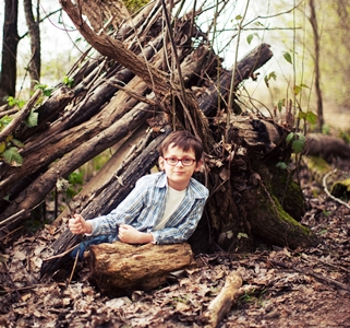 Boy Playing in Trees_credit iStock