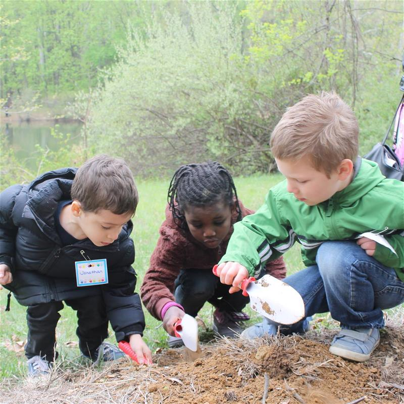 Kids looking at soil
